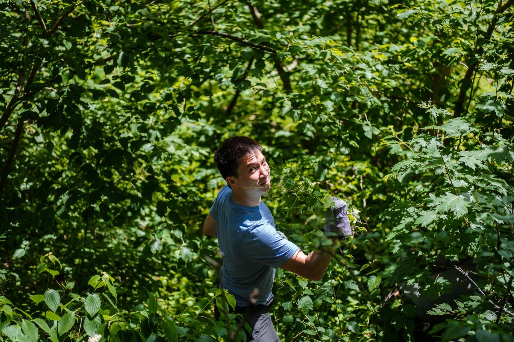 Our co-founder, Stephen, led by example and went right into the ravine to find more weeds..