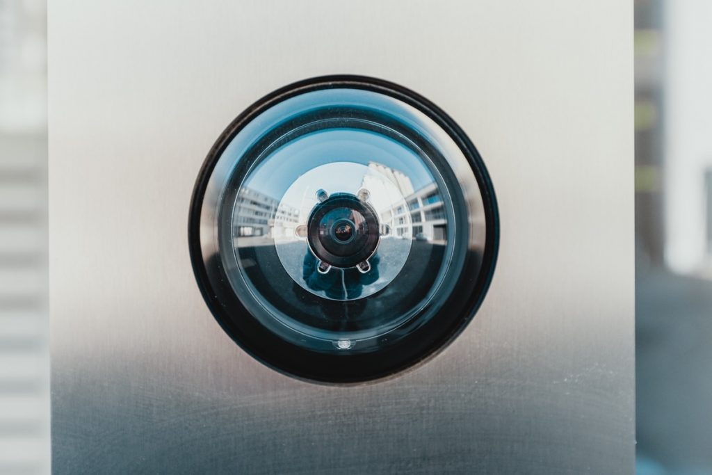 Photo of a security camera (credit to Bernard Hermant from Unsplash)
