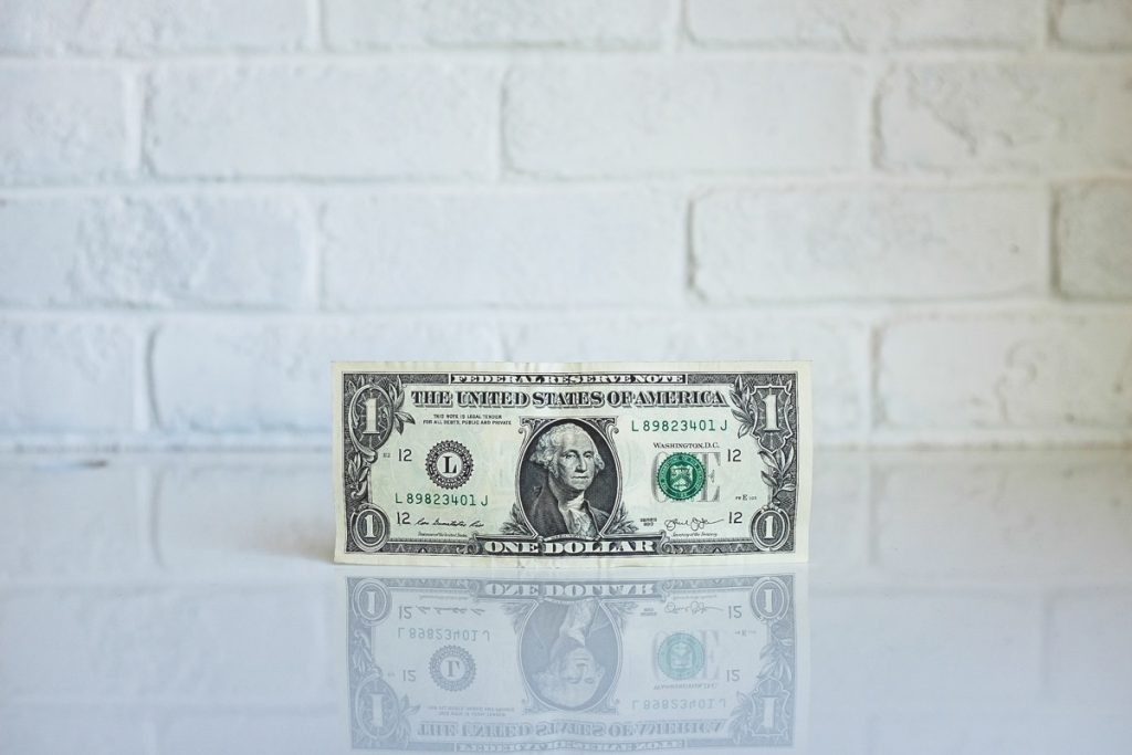 Photo of a US dollar bill (credit to neonbrand from Unsplash)
